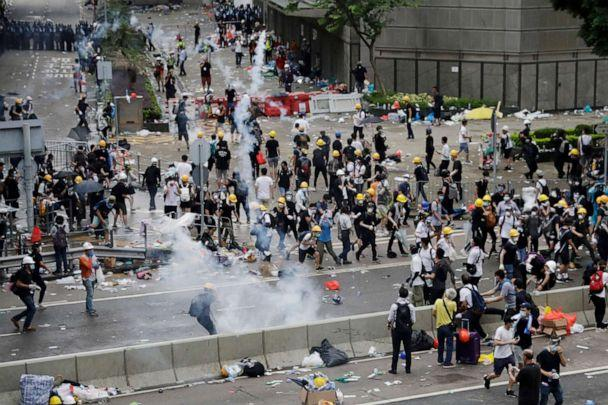 PHOTO: Riot police fire tear gas to protesters outside the Legislative Council in Hong Kong, June 12, 2019. (Vincent Yu/AP)