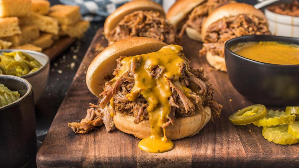 """<p>The whole hog is also prevalent in South Carolina, but it's the sauce that sets it apart from its neighbor to the north. """"<a href=""""https://www.thedailymeal.com/carolina-barbecue-burgers?referrer=yahoo&category=beauty_food&include_utm=1&utm_medium=referral&utm_source=yahoo&utm_campaign=feed"""" rel=""""nofollow noopener"""" target=""""_blank"""" data-ylk=""""slk:Carolina Gold"""" class=""""link rapid-noclick-resp"""">Carolina Gold</a>"""" is what you'll most commonly find, which is mustard-based with brown sugar and vinegar, but plenty of places also serve tomato-based and vinegar-pepper sauces as well. Chop up the meat and place it in between buns so you can enjoy it as a <a href=""""https://www.thedailymeal.com/recipes/carolina-bbq-pulled-pork-sandwich-recipe?referrer=yahoo&category=beauty_food&include_utm=1&utm_medium=referral&utm_source=yahoo&utm_campaign=feed"""" rel=""""nofollow noopener"""" target=""""_blank"""" data-ylk=""""slk:pulled pork sandwich"""" class=""""link rapid-noclick-resp"""">pulled pork sandwich</a>. The best barbecue spots in the state include Sweatman's in Holly Hill, Scott's in Hemingway and Rodney Scott's in Charleston.</p>"""