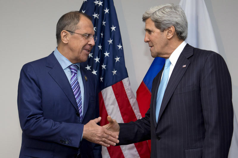 U.S. Secretary of State John Kerry, right, shakes hands with Russian Foreign Minister Sergey Lavrov before their meeting during ASEAN in Bandar Seri Begawan, Brunei on Tuesday, July 2, 2013. Kerry is expected to start the return to Washington Tuesday afternoon. (AP Photo/Jacquelyn Martin, Pool)