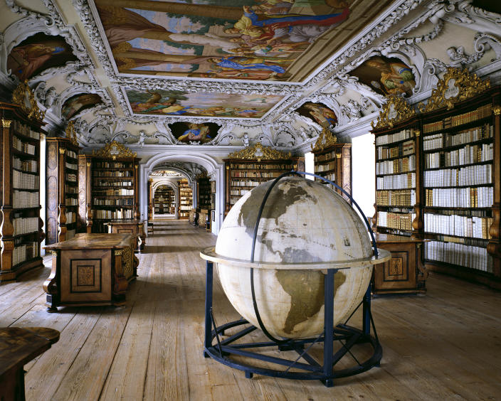 <p>Stiftsbibliothek Kremsmunster, Kremsmunster, Austria. This monastery library was built between 1680 and 1689, and holds about 160,000 volumes. (Photo: Massimo Listri/Caters News) </p>
