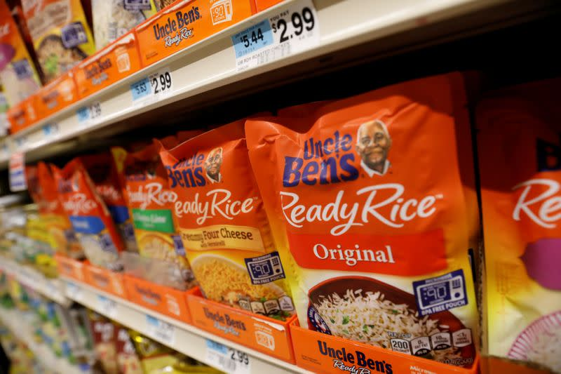 Boxes of Uncle Ben's branded rice stand on a store shelf inside of a shop in the Brooklyn borough of New York City