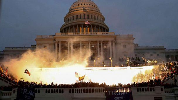 PHOTO: An explosion caused by a police munition is seen while supporters of U.S. President Donald Trump gather in front of the U.S. Capitol Building in Washington, D.C., on Jan. 6, 2021. (Leah Millis/Reuters)