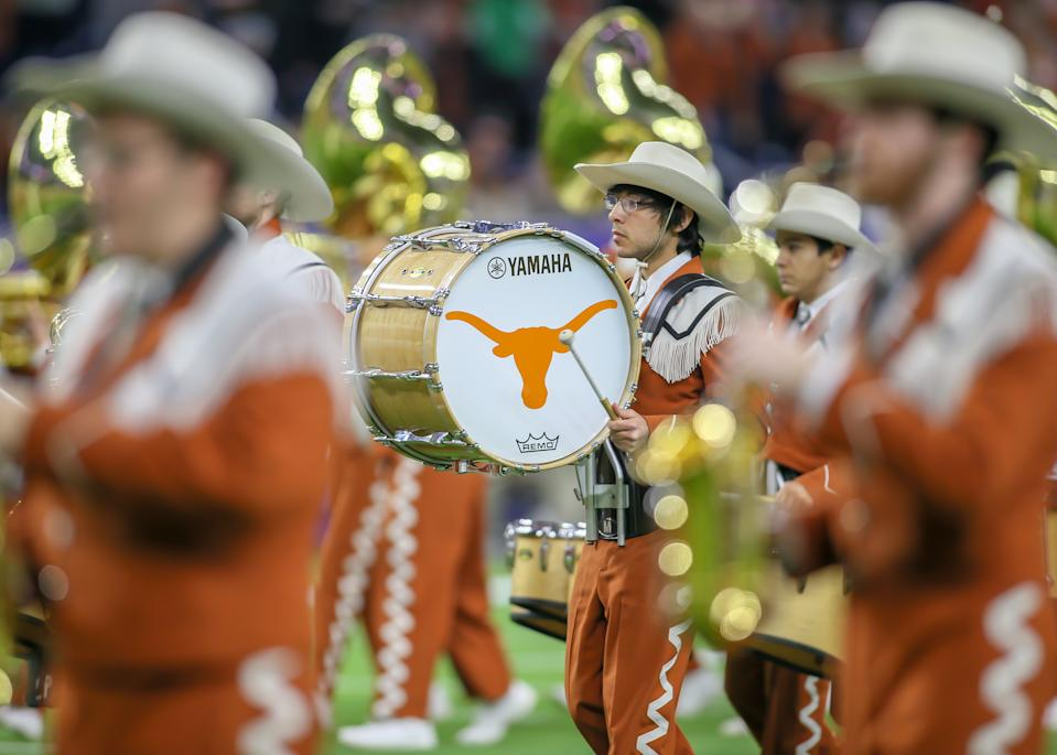 University of Texas marching band enters the field during the Texas Bowl game between the Texas Longhorns and Missouri Tigers on December 27, 2017 at NRG Stadium in Houston, Texas.(Photo by Leslie Plaza Johnson/Icon Sportswire via Getty Images)