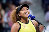 <p>Naomi Osaka speaks to the crowd after beating Marie Bouzkova of the Czech Republic during the first round of the U.S. Open in N.Y.C. on Aug. 30.</p>