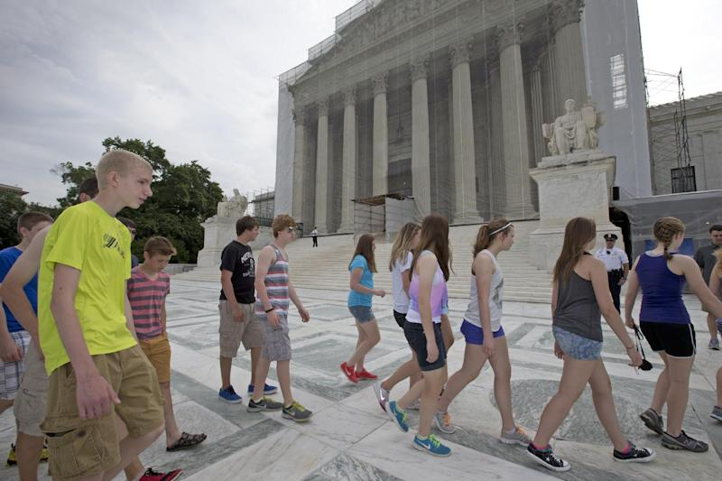 U.S. History students from Austin, Minn. High School visit the Supreme Court in Washington, Monday, June 17, 2013,  in anticipation of key decisions being announced. With a week remaining in the current Supreme Court term, several major cases are still outstanding that could have widespread political impact on same-sex marriage, voting rights, and affirmative action. (AP Photo/J. Scott Applewhite)