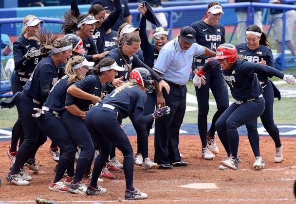 PHOTO: Kelsey Stewart #7 of Team United States jumps on home plate as the umpire and her teammates watch her score the winning run after Stewart hit a walk-off home run in the seventh inning against Team Japan. (Yuichi Masuda/Getty Images)