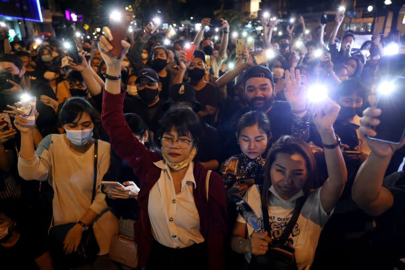 Protesters flash lights from their mobile phones while taking part in a protest against the government and to reform monarchy in Bangkok