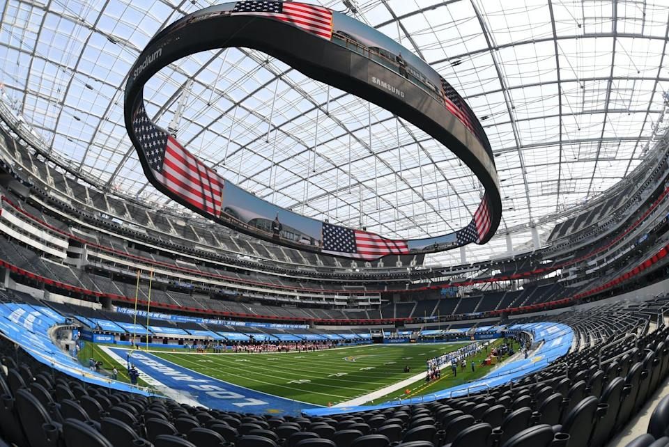 """<span class=""""caption"""">Whether stadiums can fill up next season may depend on vaccines.</span> <span class=""""attribution""""><a class=""""link rapid-noclick-resp"""" href=""""https://www.gettyimages.com/detail/news-photo/empty-seats-are-seen-before-during-the-u-s-national-anthem-news-photo/1273752187"""" rel=""""nofollow noopener"""" target=""""_blank"""" data-ylk=""""slk:Harry How/Getty Images"""">Harry How/Getty Images</a></span>"""