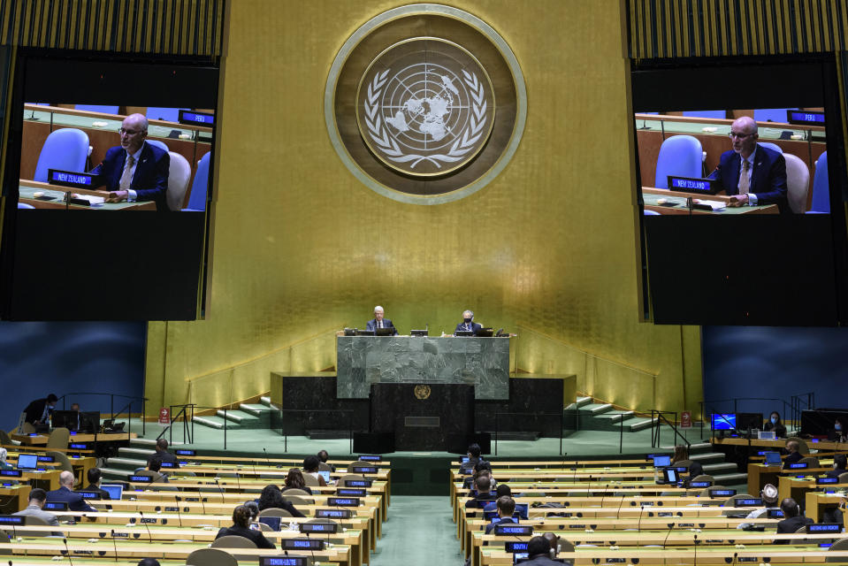 In this UN Photo, Craig John Hawke, Permanent Representative of New Zealand to the United Nations, is shown on video monitors as he speaks in person, during the 75th session of the United Nations General Assembly, Tuesday, Sept. 29, 2020, at U.N. headquarters. (Loey Felipe/UN Photo via AP)