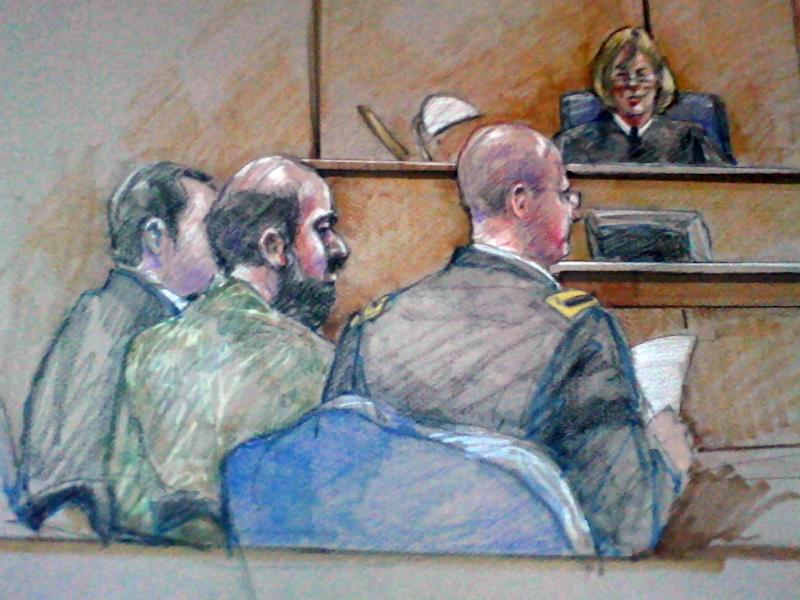 FILE - In this Dec. 18, 2012 courtroom sketch, U.S. Army Maj. Nidal Hasan, center foreground with back showing, is seen sitting between members of is defense team during a hearing in Fort Hood, Texas. The Army psychiatrist charged in the 2009 shooting rampage at Fort Hood is paralyzed from the waist down, after being shot by police that day. A judge has permitted him to represent himself at trial, but his compromised health means that his upcoming court martial will have shorter periods of testimony, more breaks and possible lengthy delays to write legal motions. (AP Photo/Brigitte Woosley, File)