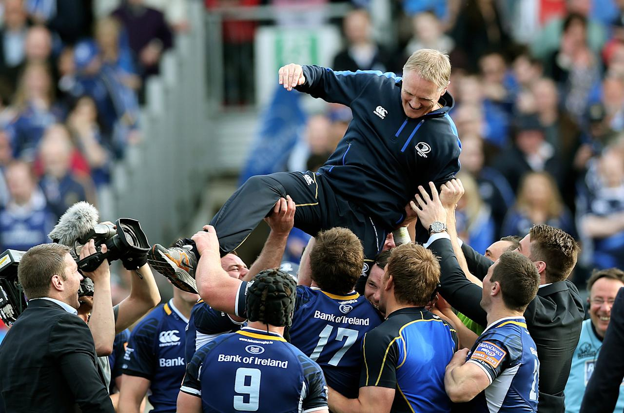 Leinster's coach Joe Schmidt is lifted in the air by his players as they celebrate during the RaboDirect PRO12 Final at the RDS, Dublin, Ireland.