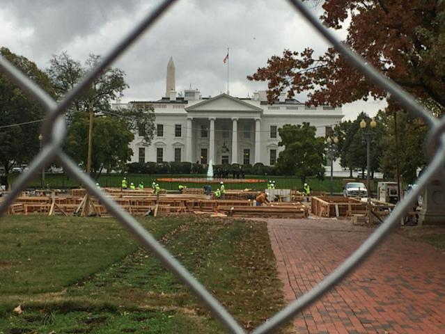 A view of the White House through fencing surrounding Lafayette Square Park on Wednesday, 9 November 2016 in Washington, DC. Americans today will choose between Republican presidential candidate Donald Trump and Democratic presidential candidate Hillary Clinton as they go to the polls to vote for the next president of the United States. (Photo by Cheriss May/NurPhoto via Getty Images)