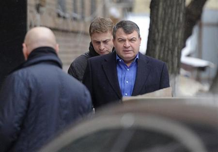 Former Russian Defence Minister Serdyukov arrives by a back entrance for questioning by investigators in Moscow