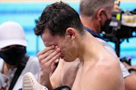 <p>Great Britain's James Guy gets overcome with emotion after winning the gold medal in the 4x200m freestyle relay at the Tokyo Aquatics Centre on July 28.</p>