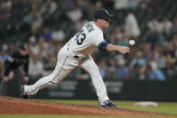 Seattle Mariners pitcher Joe Smith throws to a Houston Astros batter during the seventh inning of a baseball game, Tuesday, July 27, 2021, in Seattle. Smith was traded to the Mariners from the Astros earlier in the day. (AP Photo/Ted S. Warren)