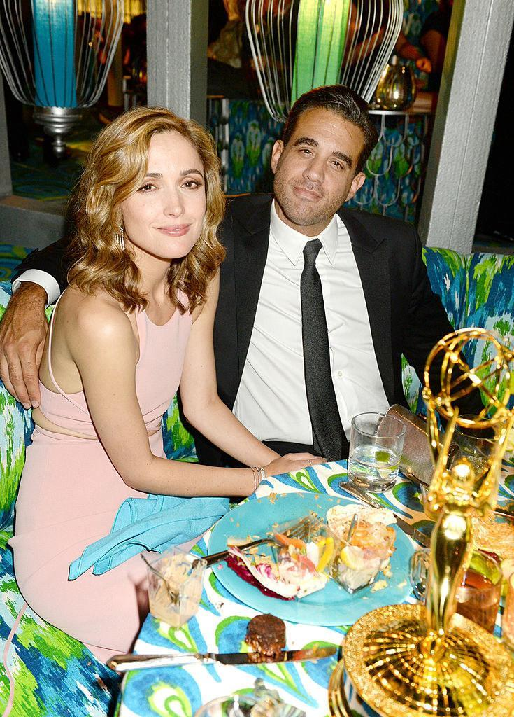 Rose Byrne (L) and Bobby Cannavale sitting at a dinner table at HBO's official Emmy after party