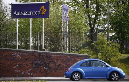 A car is driven past an AstraZeneca site in Macclesfield