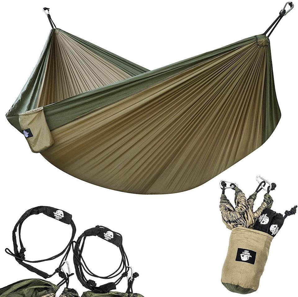 """<p><strong>Legit Camping</strong></p><p>amazon.com</p><p><strong>$29.97</strong></p><p><a href=""""https://www.amazon.com/dp/B07B31BJQJ?tag=syn-yahoo-20&ascsubtag=%5Bartid%7C2139.g.19520579%5Bsrc%7Cyahoo-us"""" rel=""""nofollow noopener"""" target=""""_blank"""" data-ylk=""""slk:BUY IT HERE"""" class=""""link rapid-noclick-resp"""">BUY IT HERE</a></p><p>This heavy duty camping hammock is great for the adventurous, outdoorsy-type of dad. He can swing, read, nap, and just hang (literally) in this travel-friendly hammock.</p>"""