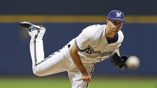 \Milwaukee Brewers' Tyler Thornburg watches a delivery to a San Diego Padres batter during the first inning of a baseball game Tuesday, Oct. 2, 2012, in Milwaukee. (AP Photo/Tom Lynn)