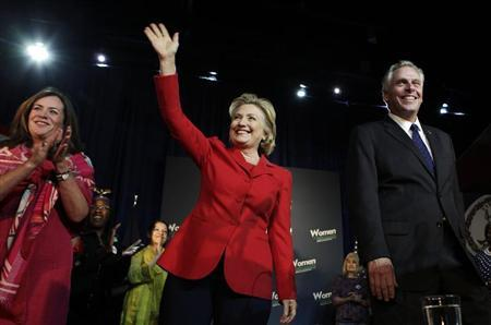 Former U.S. Secretary of State Hillary Clinton greets the audience at The State Theatre in Falls Church