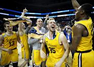 <p>The UMBC Retrievers bench reacts to their 74-54 victory over the Virginia Cavaliers during the first round of the 2018 NCAA Men's Basketball Tournament at Spectrum Center on March 16, 2018 in Charlotte, North Carolina. (Photo by Streeter Lecka/Getty Images) </p>