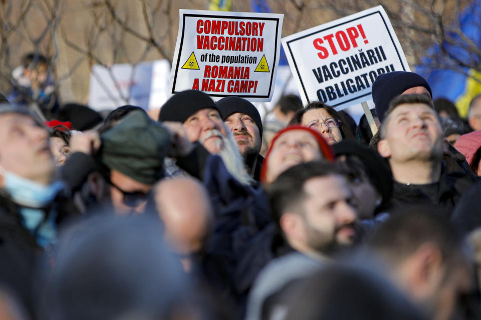 Anti-vaccination protesters rally outside the parliament building in Bucharest, Romania, Sunday, March 7, 2021. Some thousands of anti-vaccination protestors from across Romania converged outside the parliament building protesting against government pandemic control measures as authorities announced new restrictions amid a rise of COVID-19 infections. (AP Photo/Vadim Ghirda)