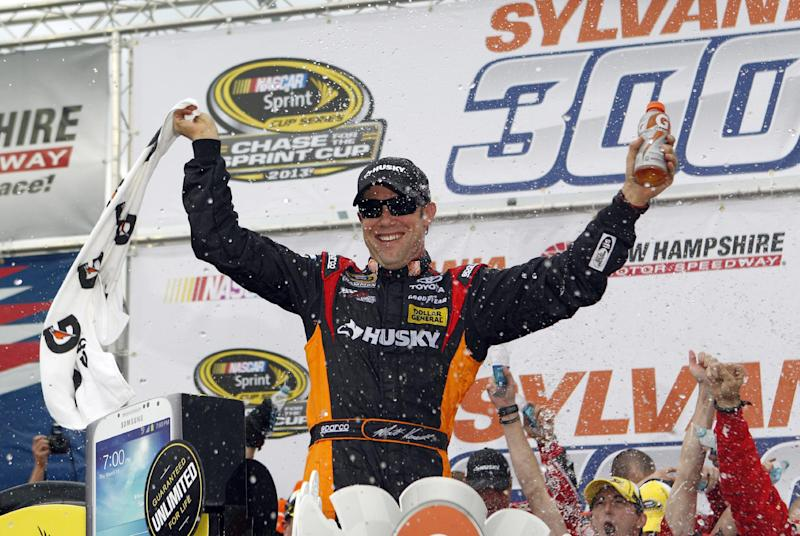 NASCAR driver Matt Kenseth celebrates in Victory Lane after winning the NASCAR Sprint Cup Series auto race at New Hampshire Motor Speedway, Sunday, Sept. 22, 2013, in Loudon, N.H. (AP Photo/Mary Schwalm)