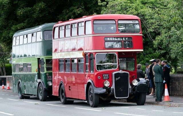 Buses that carried members of the guard of honour at Morton Cemetery, Riddlesden, Keighley, following the interment of Captain Sir Tom Moore's ashes