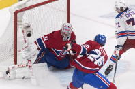 Montreal Canadiens goaltender Carey Price makes a save against New York Rangers' Filip Chytil (72) as Canadiens' Jeff Petry defends during the second period of an NHL hockey game, Saturday, Dec. 1, 2018, in Montreal. (Graham Hughes/The Canadian Press via AP)