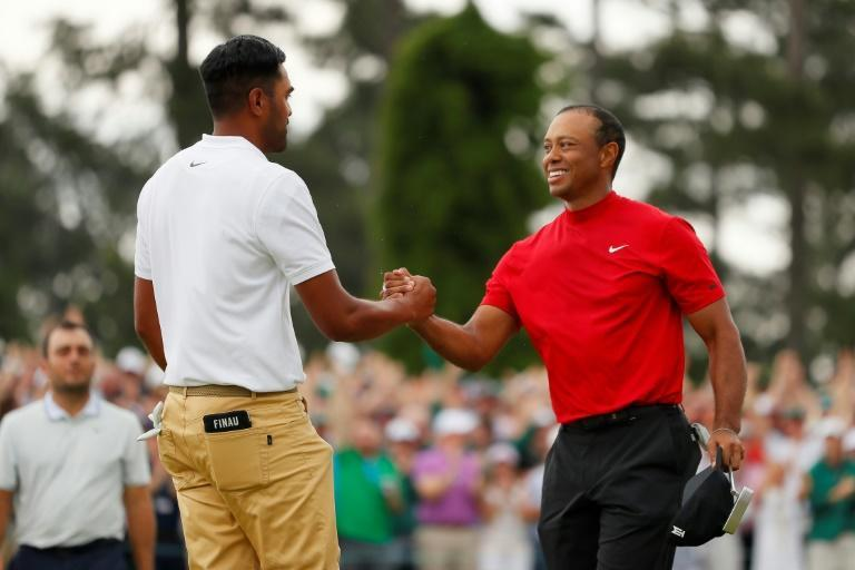 Tony Finau, at left congratulating Tiger Woods on winning the 2019 Masters, is among many PGA players who credit Woods with inspiring them to play golf