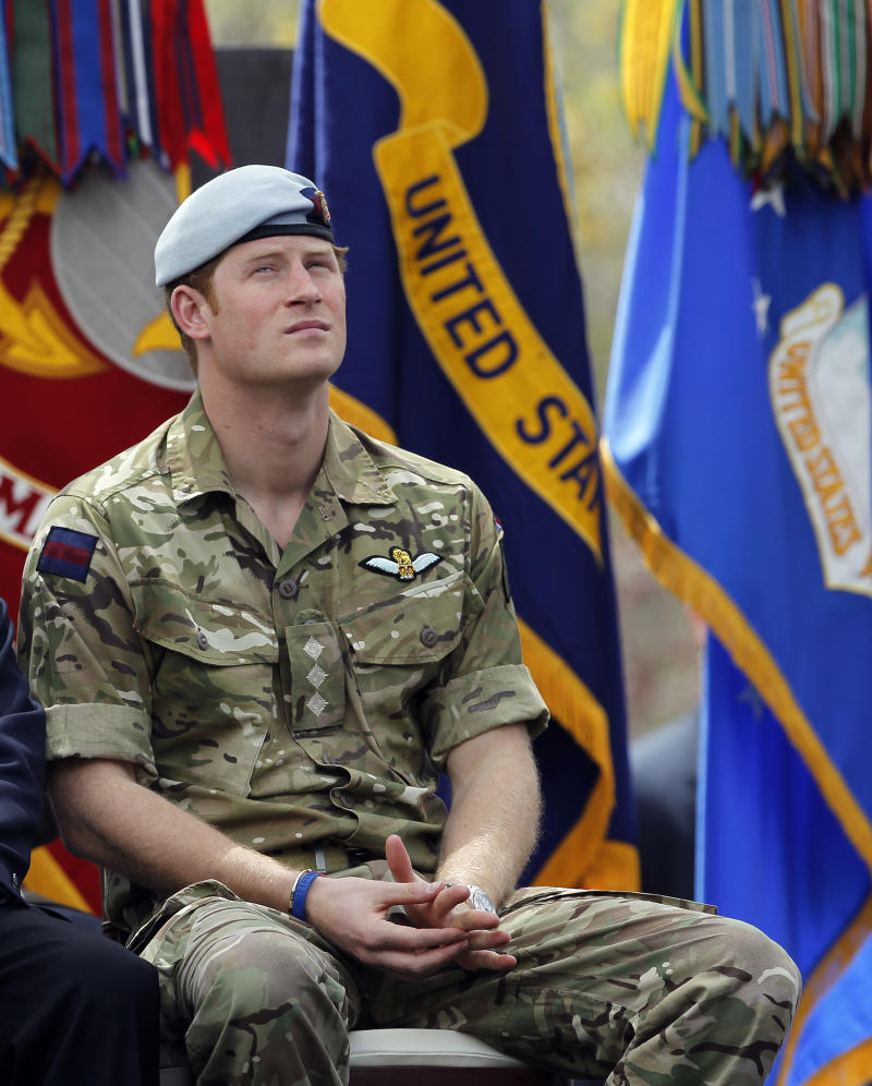 Britain's Prince Harry sits during the opening ceremony for the 2013 Warrior Games, at the U.S. Olympic Training Center, in Colorado Springs, Colo., Saturday May 11, 2013. (AP Photo/Brennan Linsley)