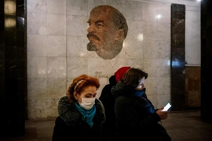 Face masks have bceome a common sight on Moscow's streets. Now Russian authorities are banning Chinese tourists over coronavirus fears (AFP Photo/Dimitar DILKOFF)