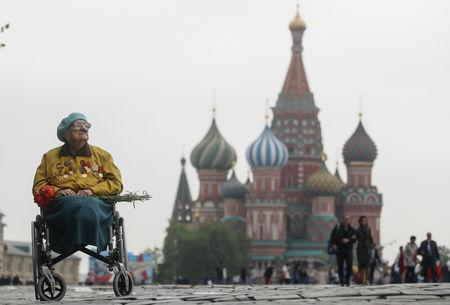 A veteran sits in a wheelchair in front of St. Basil's Cathedral after the Victory Day parade, which marks the anniversary of the victory over Nazi Germany in World War Two, in Red Square in central Moscow, Russia May 9, 2019. REUTERS/Maxim Shemetov