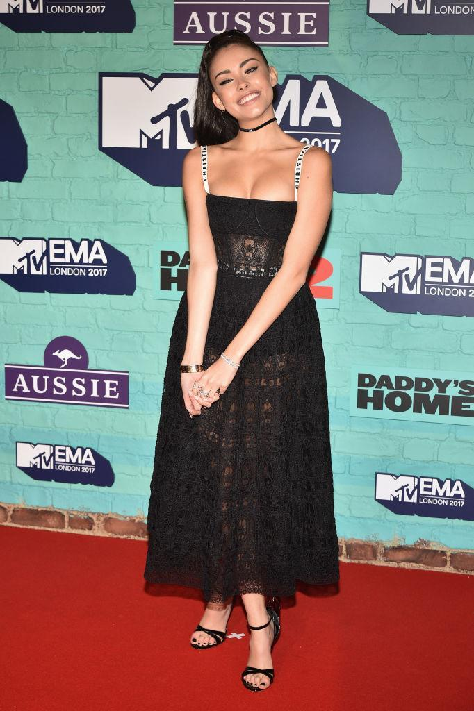 <p>Madison Beer opted for one of Dior's most sought-after dresses on the red carpet.<br>The singer slipped on Sophia Webster Black Madame Chiara heels to finish off the charming look. (Photo: Getty Images) </p>