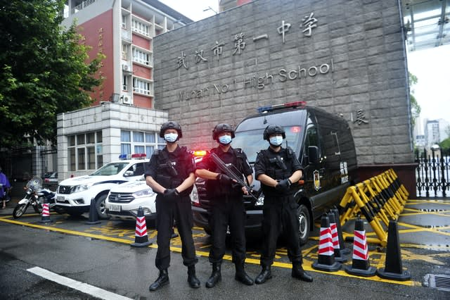 Armed police stand guard outside a testing site for China's national college entrance examinations, also known as the gaokao, in Wuhan in central China's Hubei Province (AP)