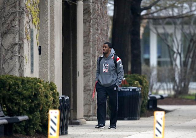 Northwestern football player Dwight White walks into McGaw Hall, where voting is taking place on the student athlete union question Friday, April 25, 2014, in Evanston, Ill. Northwestern football players cast secret ballots Friday in an on-campus hall adjacent to their home stadium on whether to form the nation's first union for college athletes. (AP Photo/Charles Rex Arbogast)
