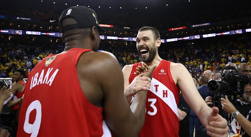 OAKLAND, CALIFORNIA - JUNE 13: Serge Ibaka #9 and Marc Gasol #33 of the Toronto Raptors celebrates their teams victory over the Golden State Warriors in Game Six to win the 2019 NBA Finals at ORACLE Arena on June 13, 2019 in Oakland, California. NOTE TO USER: User expressly acknowledges and agrees that, by downloading and or using this photograph, User is consenting to the terms and conditions of the Getty Images License Agreement. (Photo by Ezra Shaw/Getty Images)