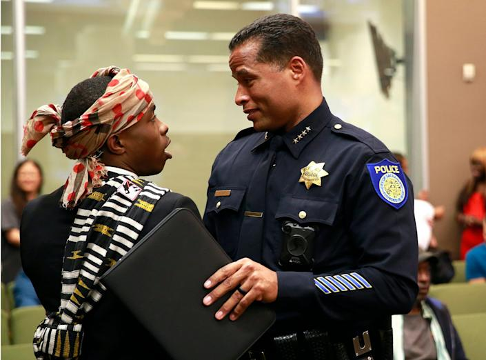 """Stevante Clark, the brother of Stephon Clark, pictured with Hahn before a city council meeting on April 10, 2018. <p class=""""copyright""""><a href=""""https://newsroom.ap.org/detail/SacramentoPoliceShooting/8b3a312fb63a46e1a4073544a974f11a/photo?Query=daniel%20hahn%20sacramento&mediaType=photo&sortBy=arrivaldatetime:desc&dateRange=Anytime&totalCount=45&currentItemNo=23"""" rel=""""nofollow noopener"""" target=""""_blank"""" data-ylk=""""slk:Rich Pedroncelli/AP"""" class=""""link rapid-noclick-resp"""">Rich Pedroncelli/AP</a></p>"""