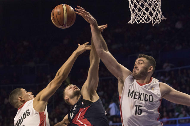 Mexico's Israel Gutierrez, right, and Irwin Avalos, left, block the ball from U.S.' Tylor Braun during the first quarter of a regular season FIBA basketball World Cup qualifier in Mexico City, Thursday, June 28, 2018. (AP Photo/Christian Palma)
