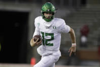 Oregon quarterback Tyler Shough carries the ball during the second half of the team's NCAA college football game against Washington State in Pullman, Wash., Saturday, Nov. 14, 2020. Oregon won 43-29. (AP Photo/Young Kwak)