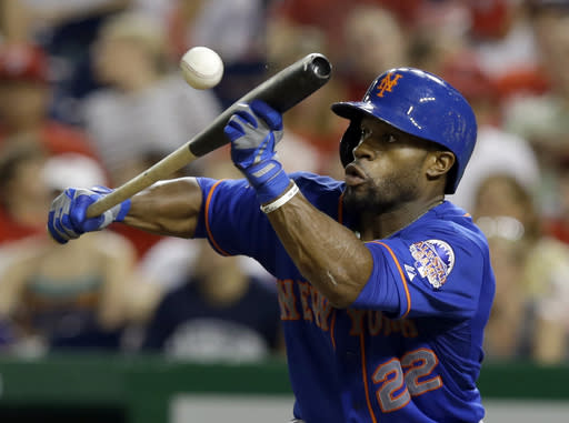 New York Mets' Eric Young Jr. (22) bunts during the fifth inning of a baseball game against the Washington Nationals at Nationals Park, Sunday, Sept. 1, 2013, in Washington. (AP Photo/Alex Brandon)