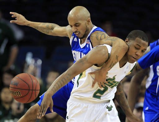 Seton Hall guard Jordan Theodore (1) elbows South Florida forward Victor Rudd (2) in the face as they chase a loose ball during the first half of an NCAA college basketball game Friday Jan. 13, 2012, in Tampa, Fla. (AP Photo/Chris O'Meara)