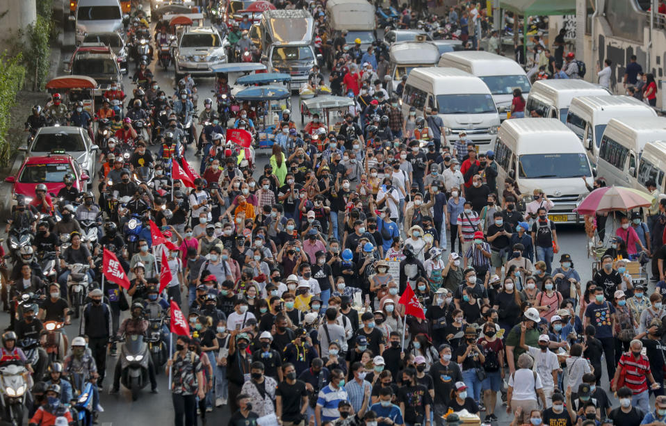 Anti-government protesters march to the criminal court during a protest in Bangkok, Thailand, Saturday, March 6, 2021. A new faction of Thailand's student-led anti-government movement calling itself REDEM, short for Restart Democracy, announced plans to march to Bangkok's Criminal Court Saturday to highlight the plight of several detained leaders of the protest movement. (AP Photo/Sakchai Lalit)