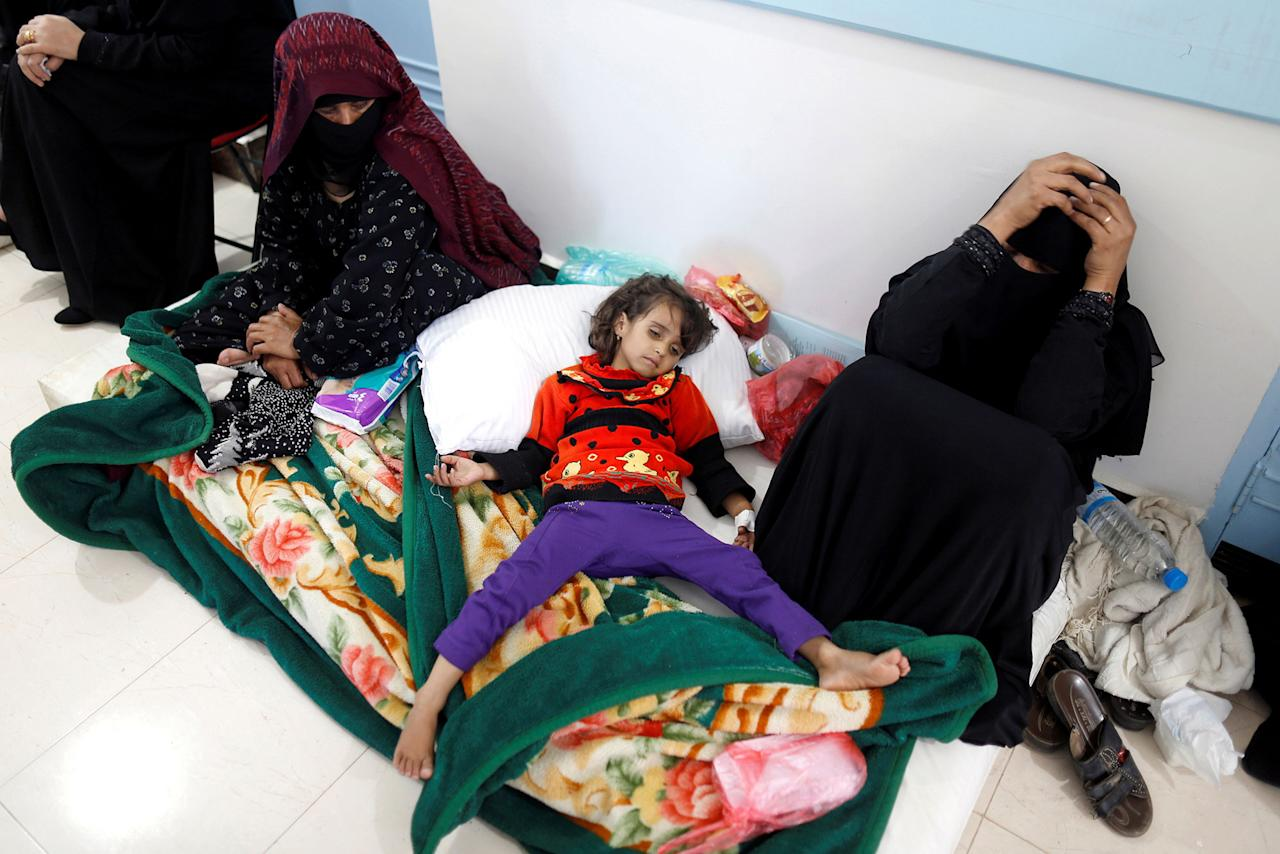 <p>A girl infected with cholera lies on the ground at a hospital in Sana'a, Yemen May 7, 2017. (Khaled Abdullah/Reuters) </p>