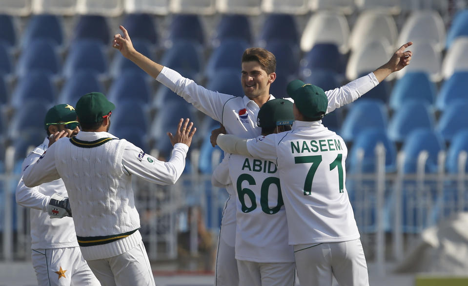 Pakistan pacer Shaheen Shah Afridi, center, celebrates with teammates after taking the wicket of Bangladesh batsman Saif Hassan during the first day of their 1st test cricket match at Rawalpindi cricket stadium in Rawalpindi, Pakistan, Friday, Feb. 7, 2020. (AP Photo/Anjum Naveed)