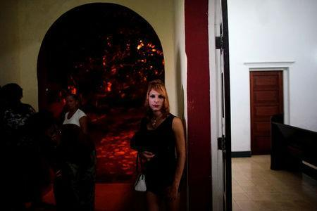 Trans Andy Cuadrado, 21, stands at the door of a chapel after a mass in Matanzas, Cuba, May 5, 2017. Picture taken on May 5, 2017. REUTERS/Alexandre Meneghini