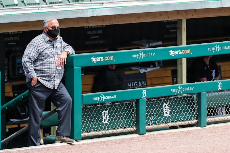 Detroit Tigers general manager Al Avila watches practice from the dugout during summer camp at Comerica Park in Detroit, Tuesday, July 7, 2020.
