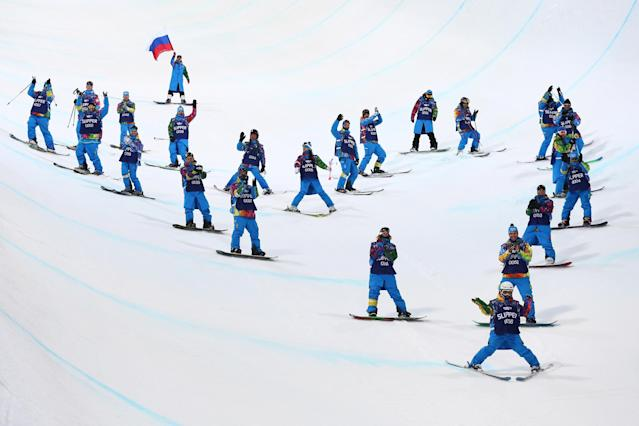 SOCHI, RUSSIA - FEBRUARY 20: Volunteers ski down the course after the Freestyle Skiing Ladies' Ski Halfpipe Finals on day thirteen of the 2014 Winter Olympics at Rosa Khutor Extreme Park on February 20, 2014 in Sochi, Russia. (Photo by Cameron Spencer/Getty Images)