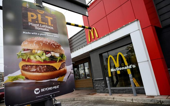"""A sign promoting McDonald's """"PLT"""" burger with a Beyond Meat plant-based patty - REUTERS/Moe Doiron"""