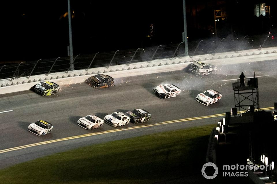 """Justin Haley, Kaulig Racing, Chevrolet Camaro leads the field in the last lap as Austin Cindric, Team Penske, Ford Mustang and A.J. Allmendinger, Kaulig Racing, Chevrolet Camaro wreck each other <span class=""""copyright"""">Lesley Ann Miller / Motorsport Images</span>"""